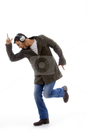 Side view of man enjoying music stock photo, Side view of man enjoying music against white background by Imagery Majestic
