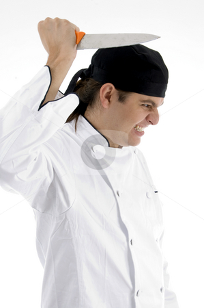 Angered chef posing with knife stock photo, Angered chef posing with knife against white background by Imagery Majestic