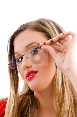 Female model holding her spectacles stock photo, Female model holding her spectacles on an isolated white background by Imagery Majestic