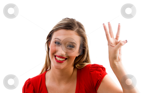 Female model with counting fingers stock photo, Female model with counting fingers against white background by Imagery Majestic