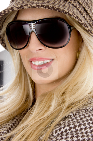Front view of smiling model wearing sunglasses stock photo, Front view of smiling model wearing sunglasses against white background by Imagery Majestic
