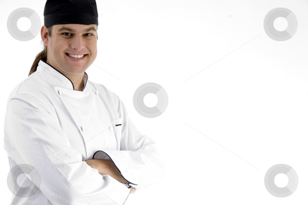 Happy male chef posing in front of camera stock photo, Happy male chef posing in front of camera with white background by Imagery Majestic