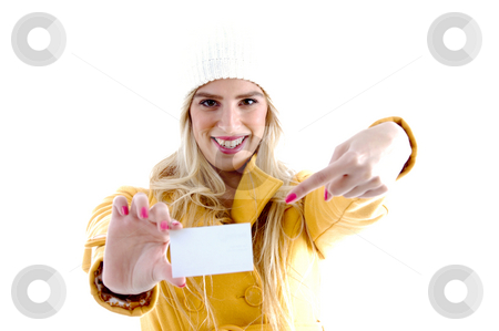 Front view of smiling woman pointing towards business card stock photo, Front view of smiling woman pointing towards business card on an isolated white background by Imagery Majestic