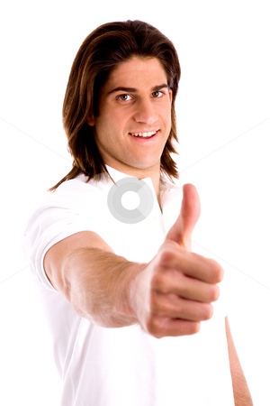 Side view of model with thumbs up stock photo, Side view of model with thumbsup against white background by Imagery Majestic