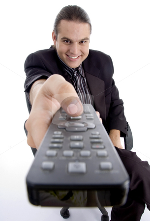 Businessman watching television stock photo, Businessman watching television on an isolated white background by Imagery Majestic