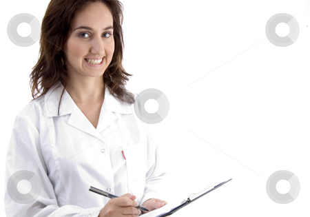 Professional lady doctor note down medical prescription stock photo, Professional lady doctor note down medical prescription against white background by Imagery Majestic