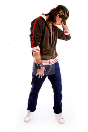 Young male posing music style stock photo, Side pose of young male posing on an isolated white background by Imagery Majestic