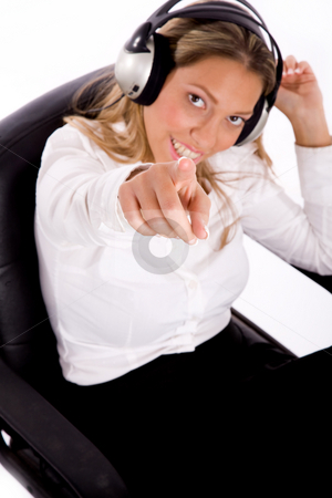 Top view of businesswoman listening music stock photo, Top view of businesswoman listening music against white background by Imagery Majestic