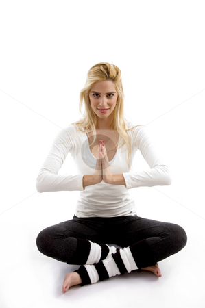 Front view of woman practicing yoga stock photo, Front view of woman practicing yoga with white background by Imagery Majestic
