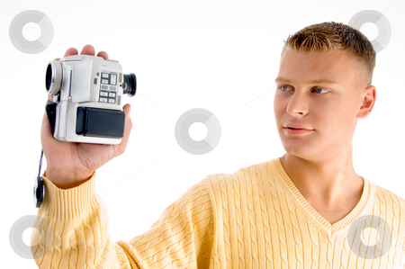Portrait of man with handy cam stock photo, Portrait of man with handy cam against white background by Imagery Majestic