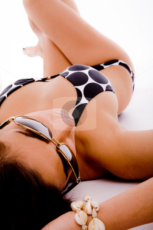 Top view of laying sensuous woman with sunglasses stock photo, Top view of laying sensuous woman with sunglasses on an isolated white background by Imagery Majestic
