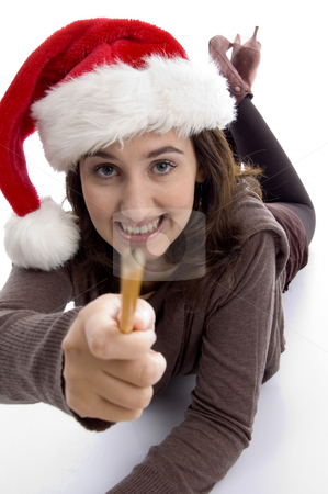 Young student in christmas hat showing her pencil stock photo, Young student in christmas hat showing her pencil with white background by Imagery Majestic