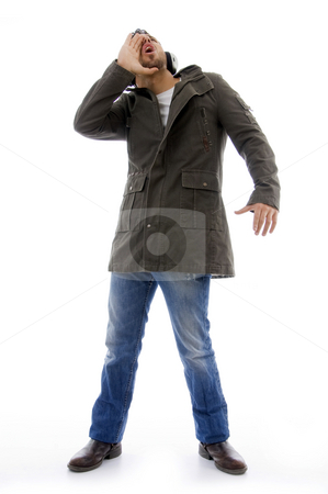 Man listening to music  stock photo, Man listening to music on an isolated white background by Imagery Majestic