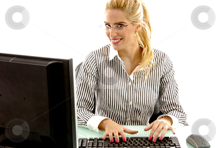 Front view of  female working on computer stock photo, Front view of  female working on computer in an office by Imagery Majestic