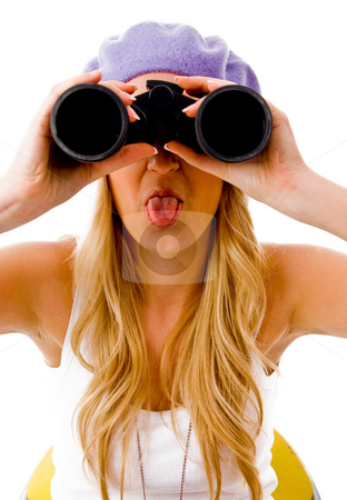 Front view of young woman looking through binocular stock photo, Front view of young woman looking through binocular on an isolated background by Imagery Majestic