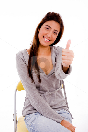Woman showing thumbs up stock photo, Side view of smiling woman showing thumb up on an isolated background by Imagery Majestic