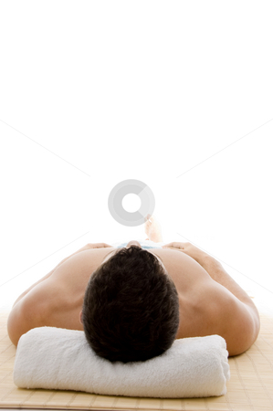 Front view of man lying down for spa treatment  stock photo, Front view of man lying down for spa treatment on an isolated background by Imagery Majestic