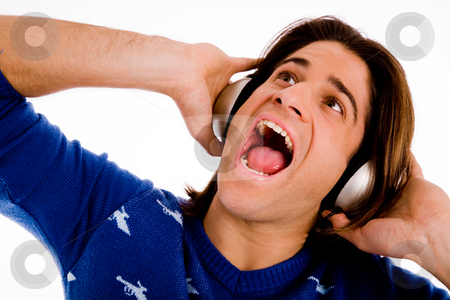 Male enjoying music and singing stock photo, Portrait of shouting male enjoying music on an isolated white background by Imagery Majestic