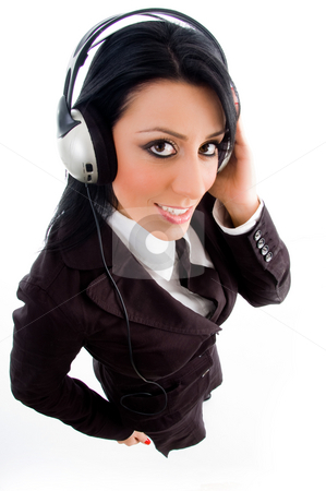 Young accountant holding headphone stock photo, Young accountant holding headphone on an isolated white background by Imagery Majestic