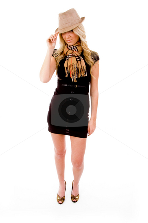 Front view of smiling female holding her hat stock photo, Front view of smiling female holding her hat on an isolated white background by Imagery Majestic