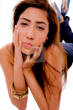 Front view of smiling young female holding her face stock photo, Front view of smiling young female holding her face on an isolated white background by Imagery Majestic