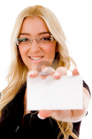 Front view of smiling woman showing business card stock photo, Front view of smiling woman showing business card on an isolated white background by Imagery Majestic