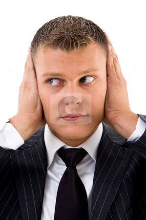Man trying to stop loud noise with his hands stock photo, Man trying to stop loud noise with his hands against white background by Imagery Majestic
