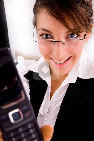 Front view of smiling businesswoman showing her cellphone stock photo, Front view of smiling businesswoman showing her cellphone by Imagery Majestic