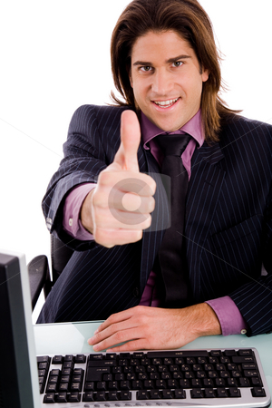 Front view of smiling manager with thumbsup stock photo, Front view of smiling manager with thumbsup on an isolated white background by Imagery Majestic