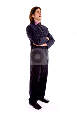 Full body man with folded hands stock photo, Side view of young man with folded hands on an isolated white background by Imagery Majestic