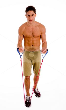 Full body of exercising man stock photo, Full body of exercising man on an isolated background by Imagery Majestic