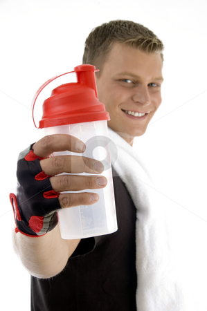Exercising male showing bottle stock photo, Exercising male showing bottle with white background by Imagery Majestic