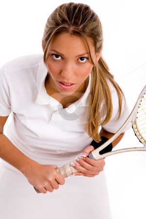 Front view of tennis player looking at camera stock photo, Front view of tennis player looking at camera on an isolated background by Imagery Majestic