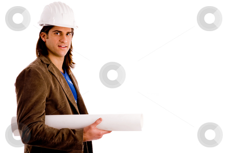 Portrait of architect holding blueprints stock photo, Portrait of architect holding blueprint against white background by Imagery Majestic