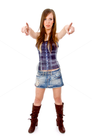 Front view of beautiful young model pointing stock photo, Front view of beautiful young model pointing on an isolated background by Imagery Majestic