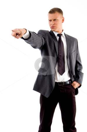 Standing manager pointing sideways stock photo, Standing manager pointing sideways on an isolated white background by Imagery Majestic