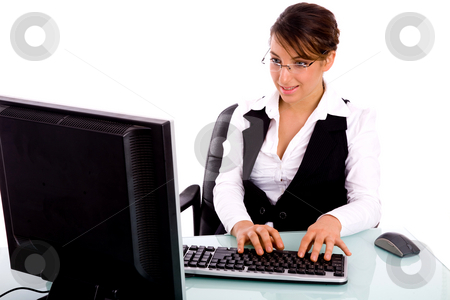 Front view of woman executive working on computer stock photo, Front view of woman executive working on computer in an office by Imagery Majestic