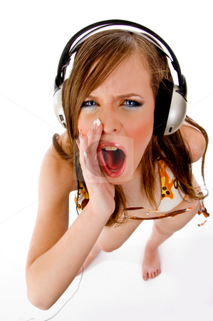 Top view of shouting female enjoying music stock photo, Top view of shouting female enjoying music with white background by Imagery Majestic