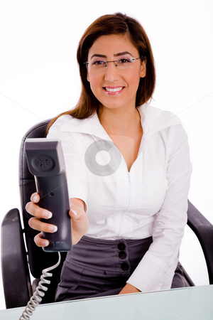 Secretary on phone call stock photo, Front view of executive offering call on an isolated background by Imagery Majestic