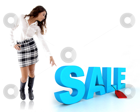 Woman pointing at three dimensional sale text stock photo, Woman pointing at three dimensional sale text by Imagery Majestic