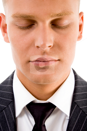 Man posing with closed eyes stock photo, Man posing with closed eyes on an isolated background by Imagery Majestic
