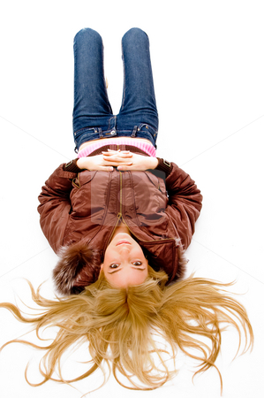 Top view of laying sexy female looking at camera stock photo, Top view of laying sexy female looking at camera on an isolated background by Imagery Majestic