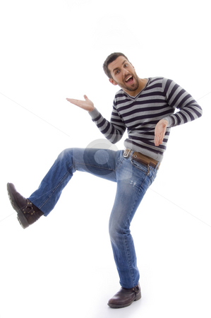 Side view of amused man dancing  stock photo, Side view of amused man dancing against white background by Imagery Majestic