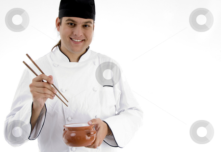 Chef presenting chinese dish with chopstick stock photo, Chef presenting chinese dish with chopstick against white background by Imagery Majestic