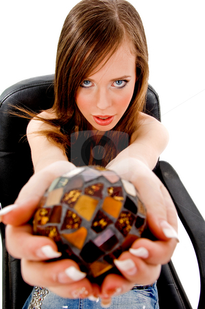 Top view of sitting woman showing christal ball stock photo, Top view of sitting woman showing christal ball against white background by Imagery Majestic