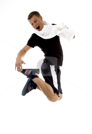 Jumping man looking his shoes stock photo, Jumping man looking his shoes on an isolated background by Imagery Majestic