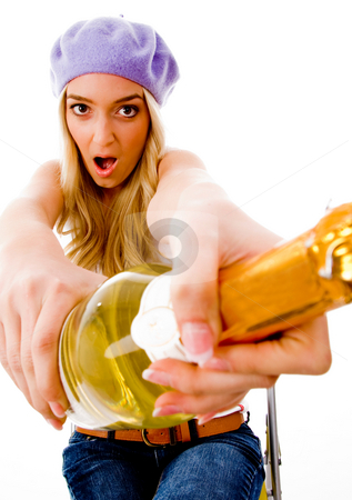 Front view of surprised woman with champagne stock photo, Front view of surprised woman with champagne on an isolated background by Imagery Majestic