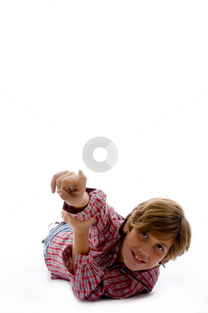 Front view of smiling child pointing stock photo, Front view of smiling child pointing against white background by Imagery Majestic