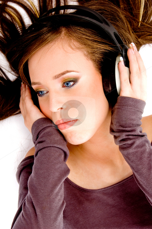 Top view of model listening music stock photo, Top view of model listening music on an isolated background by Imagery Majestic