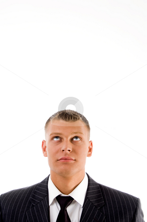 Close up view young man looking upwards stock photo, Close up view young man looking upwards against white background by Imagery Majestic